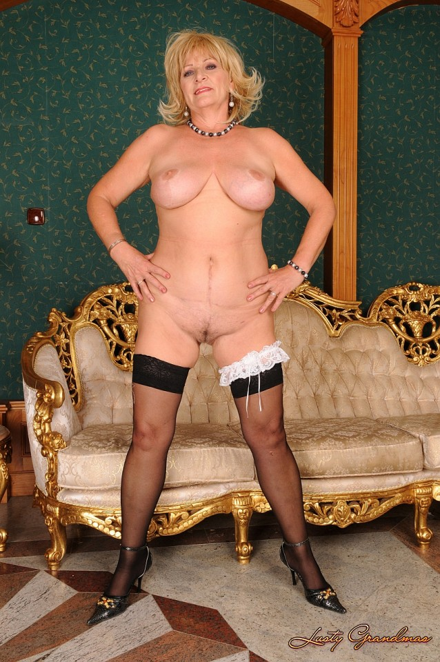 Granny with hanging tits works her old pussy 9